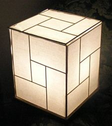 "A cheap but attractive ""shoji"" style lamp that uses mostly recycled parts and is easy to put together."