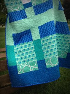 This baby quilt is gender neutral and would be a great gift. Soft minky cuddle fleece on the back. FOR SALE