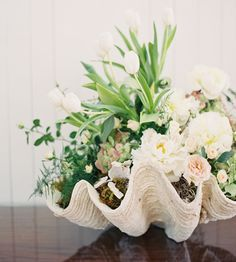 Image from http://pixel.brit.co/wp-content/uploads/2014/07/flowers-in-a-seashell1.jpg.