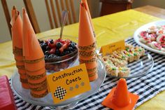 lots of themed food for a Cars party  Idea: dip bugles in orange candy.coat.