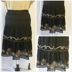 "3 Tiered, Embroidered Crochet Sheer Lined Skirt DETAILS! In person this skirt has beautiful details! 3 Tiered, Crinkled, Embroidered,  Crochet, Sheer, Lined, Skirt with side zipper. Under lining doesn't go full length of sheer outer detailed skirt so light will emphasize the bottom embroidered ruffled tier. Eye catching feminine movement.  Shell 97%polyester 3% spandex,  lining 100% acetate,  embroidery 100% polyester. 17"" waist, 25"" length. The tag says 0 but SEE MEASUREMENTS ... 34"" waist…"