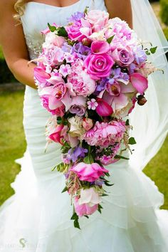 Gorgeous Cascading Wedding Bouquet Featuring: Pink, Hot Pink, Lavender & Champagne Roses, Pink Peonies, Pink Calla Lilies, Pink Dianthus, Pink Cymbidium Orchids, Lavender Freesia, White Astilbe & Greenery/Foliage