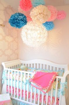 pretty baby girls room. I love the idea of the ligthing and the poms