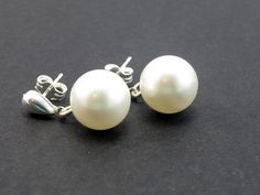 NO THESE ARE THE MOST PERFECT!!!! Pearl Drop Stud Earrings, 10mm White Swarovski Crystal Pearls, Stainless Steel Posts, Silver Smooth Teardrops. $18.00, via Etsy.