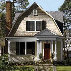 CURB APPEAL – another great example of beautiful design. Our new home is a Dutch Colonial Revival built in so I'm looking around for curb appeal ideas. House With Porch, House Roof, Gambrel Roof Trusses, Dutch Gable Roof, Enclosed Front Porches, Dutch Colonial Homes, Usa House, Architectural Features, Roof Design