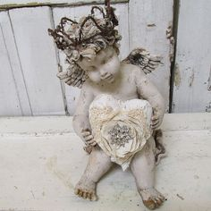 Large sitting cherub statue holding a heart by AnitaSperoDesign