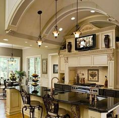 Stunning kitchen design; loving the ceiling and cabinetry! | http://www.homechanneltv.com/photos-kitchen-designs.html