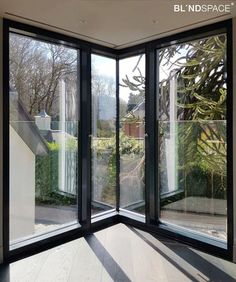 Corner window with concealed roller blinds. This shows the most common corner configuration, with one blind passing the other to minimize the visible gap between the two blinds.