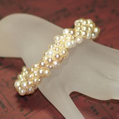 Shinju ... Faux Pearl . Bead Crochet Bracelet . Handmade . Bridal Wear . Wedding . Feminine . Ivory . Textural . Silver Tone Clasp. $44.00, via Etsy.