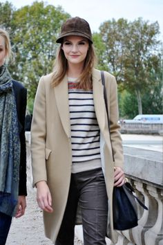 40 Street Style Snaps From Paris Fashion Week  Representing at-ease glamour with French sailor stripes.