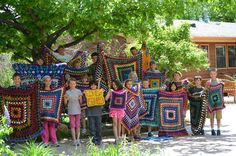 Shining Mountain Waldorf School Community Our Third Grade Class proudly displaying the fruits of their labors in this year's Handwork class- crocheted granny squares!
