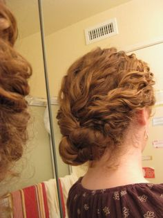 up-do curly hair. This is truly a dream style for me seeing as I can't even french braid my hair :(