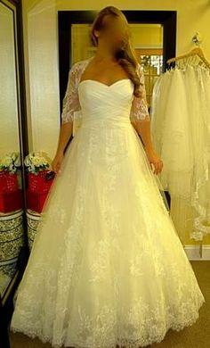 Pronovias Decada 8: buy this dress for a fraction of the salon price on PreOwnedWeddingDresses.com