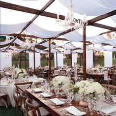 Bloom Box Designs, outdoor wedding, wedding reception, wood beams, draping, chandeliers, centerpieces, wooden chairs, luxury wedding, Fancy That! Event Design and Coordination, Hummingbird Nest Ranch, floral design company, featured on LoveLuxeLife, see more at www.loveluxelife.com, #loveluxelife