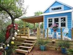 "Cheery Beach Cottage - This tiny beach cottage on Florida's St. George Island is called ""Our Little Secret"" by its owners. Including the loft space, the 325-square-foot cottage sleeps two to four people, while a generous deck expands the living space into the outdoors for a perfect vacation retreat."