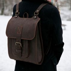 Leather backpack handmade of genuine lather and orange stitching
