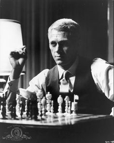 Steve McQueen in The Thomas Crown Affair.  The remake with Pierce Brosnan is really good, too.