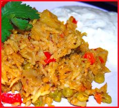 A recipe for a delicious biryani with mixed vegetables, including carrots, red peppers, potatoes and green peas. Vegan coriander raita.