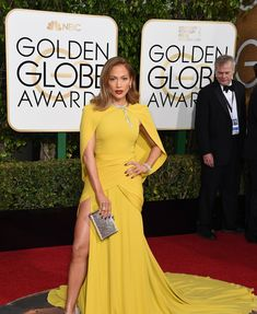 Jennifer Lopez in a Giambattista Valli Haute Couture dress, Harry Winston jewelry, and Jimmy Choo shoes