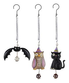 Hang this ornament set in a nook or cranny for a spooky Halloween decorating scheme. With playfully springy hangers and eerie designs, these pieces will last for many trick-or-treating seasons to come.