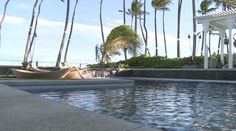 Nunu - Honolulu, Hawaii Beachfront Rental. Nunu is located on Honolulu, Hawaii's beautiful Kahala beachfront.   Fragrant ginger and shower tree blossoms awaken your senses as you enter this grand, beachfront estate. An ancient grove of coconut palms, that sway in the gentle trade winds, peek over the graceful roofline which echoes old time kama'aina charm.  The grass accentuated motor court provides private parking for five cars in addition to the three car garage. (7 -8 if stacked parking)…