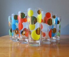 This fabulous set of glasses was designed by Russel Wright in 1957 for Bartlett-Collins. The overlapping colorful dot pattern is called Eclipse. Etsy sold for $225