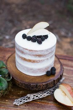 Blackberries & apple slices top off this delectable naked cake | Image by M. Felt Photography