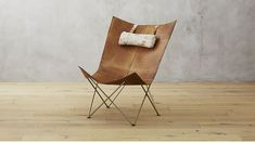 Shop Brown Leather Butterfly Chair with Hide Headrest. Modern take on legendary design shelters with cocoon-like comfort. Brass frame's accordion shape supports leather sling with worn vintage look and rustic cowhide headrest.