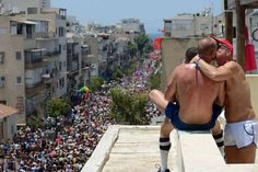 Two men are kissing while watching from a roof ar the annual gay pride parade in Tel Aviv, June 09, 2017. About 200,000 members of the Israeli and international gay community participated the annual gay pride parade in Tel Aviv.  Photo: NurPhoto/NurPhoto Via Getty Images