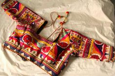 Completely ethnic blouse design, has a kitschy appeal. | PATAKA GUDDI