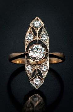 A Vintage Russian Art Deco Diamond Ring c. 1930 7 brilliant diamonds (approximately 1.25 ct total weight) set in white and yellow gold (750 - 18K)
