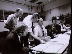 Capcom consol during the Apollo 13 mission.  Sitting L-R:  Deke Slayton, Jack Lousma, John Young.  Standing L-R:  Ken Mattingly, Vance Brand.