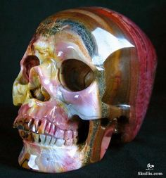 Rainbow-hued mineral skull