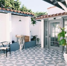 Modern geometric patterned floor tiles in an outdoor patio space