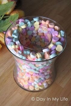 Take two different size vases and sprinkle candy hearts between them and voilà: the perfect centerpiece for your Valentine's Day party decor! (You can by cheap vases from the dollar store.) this can be done for do many holidays! Valentines Day Party, Valentines Day Decorations, Valentine Day Crafts, Easter Crafts, Happy Valentines Day, Valentine Table Decor, Walmart Valentines, Pinterest Valentines, Valentines Sweets