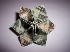Origami Dollar Flower (Make a flower out of bigger denomination bills and package the flower in small gift box OR, make multiple flowers using 1 dollar bills and attach the flowers to a branch to make a money tree gift)