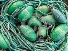 LUARCA, SPAIN - DECEMBER 4, 2016: Green fishing gear at the fish market pier in Luarca, Spain.