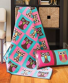 Each quilt block in this whimsical quilt has an adorable owl made up of simple fused and machine appliquéd shapes. Make a quilted pillow to match.