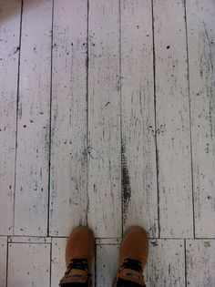 Rustic white washed floor boards.