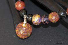 Perlenkette mit Perlen aus Polymer Clay (Mokume Gane-Technik)    Farben: gelb, lila, kupfer, gold).    Bestehend aus folgender *Farb- und Materialkomb