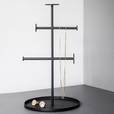 Shop Designstuff for a range of Scandinavian home decor and kitchenwares, including this minimalist Norm Collector Jewellery Stand in Black by MENU