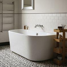 Black and white cement tile, white modern tub, and white subway tile.