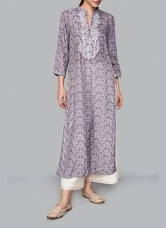 Anita Dongre Featuring a grey long kurta in modal silk base with hand block print motifs of wild flowers and natural canopies from the forests of Ranthambore all over, three fourth sleeves and narrow v-neck. Silk Kurti Designs, Kurta Designs Women, Indian Attire, Indian Outfits, Indian Wear, Indian Style, Indian Fashion Designers, Indian Designer Wear, Punjabi Dress