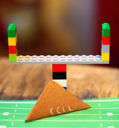 Hut, hut, HIKE! DIY Tabletop Football is a great way to entertain the kiddos while you watch the big game. | AllFreeKidsCrafts.com