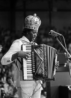 Clifton Chenier (June 25, 1925 - December 12, 1987), a Creole French-speaking native of Opelousas, Louisiana, was an eminent performer and recording artist of Zydeco, which arose from Cajun and Creole music, with R, jazz, and blues influences. He played the accordion and won a Grammy Award in 1983. He also was recognized with a National Heritage Fellowship, and in 1989 was inducted posthumously into the Blues Hall of Fame.  He was known as the 'King of Zydeco'.