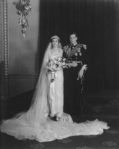 1934 Princess Marina and The Duke of Kent were wed at Westminster Abbey.   Marina wowed the  press & public when she alighted from her carriage at Westminster Abbey,  wearing a  gown that was the picture of 1930's glamour. The fabric was of shimmering silver and white brocade with a raised English rose design. jj