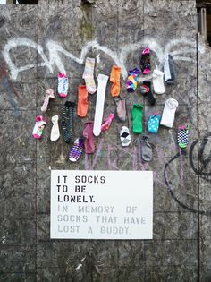 """It socks to be lonely. In memory of socks that have lost a buddy."" This is too funny. Need to utilize this idea in the laundry room in hopes or reuniting them. Street Installation, Interactive Installation, Bedford Avenue, Lost Socks, Make Me Smile, Lonely, Haha, Street Art, Geek Stuff"