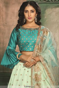 A blouse is a traditional top worn by women in India. There are endless designs of blouse patters which are available Sari Blouse Designs, Choli Designs, Blouse Patterns, Lehenga Top, Blue Lehenga, Bell Sleeve Blouse, Bell Sleeves, Simple Lehenga, Stylish Blouse Design