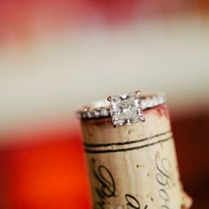 Great creative! Consider taking engagement photos that fit with the theme of your wedding -- like this couple's vineyard & wine theme!