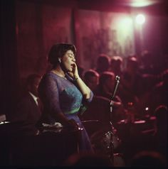 . 'I'm no glamour girl,' she once remarked, 'but God gave me this talent, so I just stand there and sing.'  Ella Fitzgerald performing in a Chicago nightclub in 1958